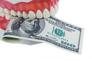 dental mold holding money