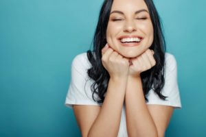young woman excited about the benefits of smiling