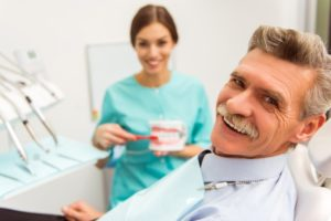 man at a consultation for dentures